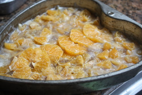 Place the citrus pieces in the melted butter and brown sugar...