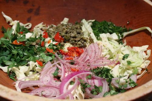 Toss the veggies in the vinegar and salt.