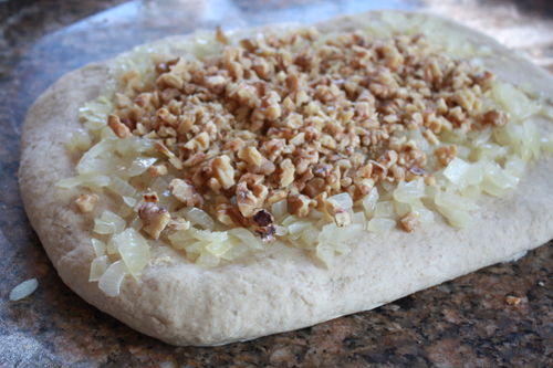Pour drained onions & toasted walnuts over flattened dough.